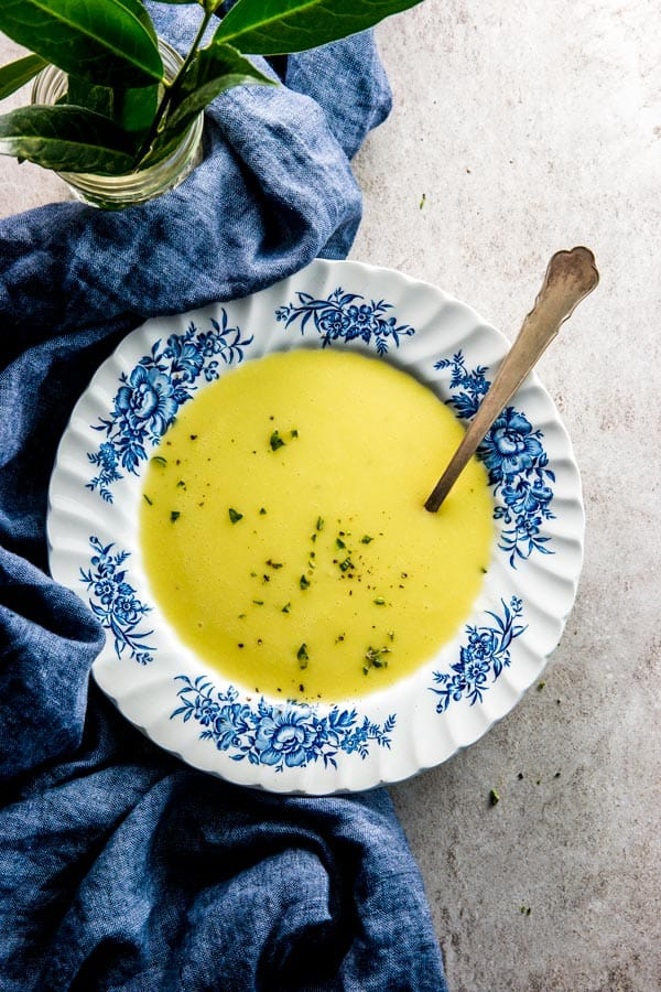 overhead view on floral plate with potato leek soup