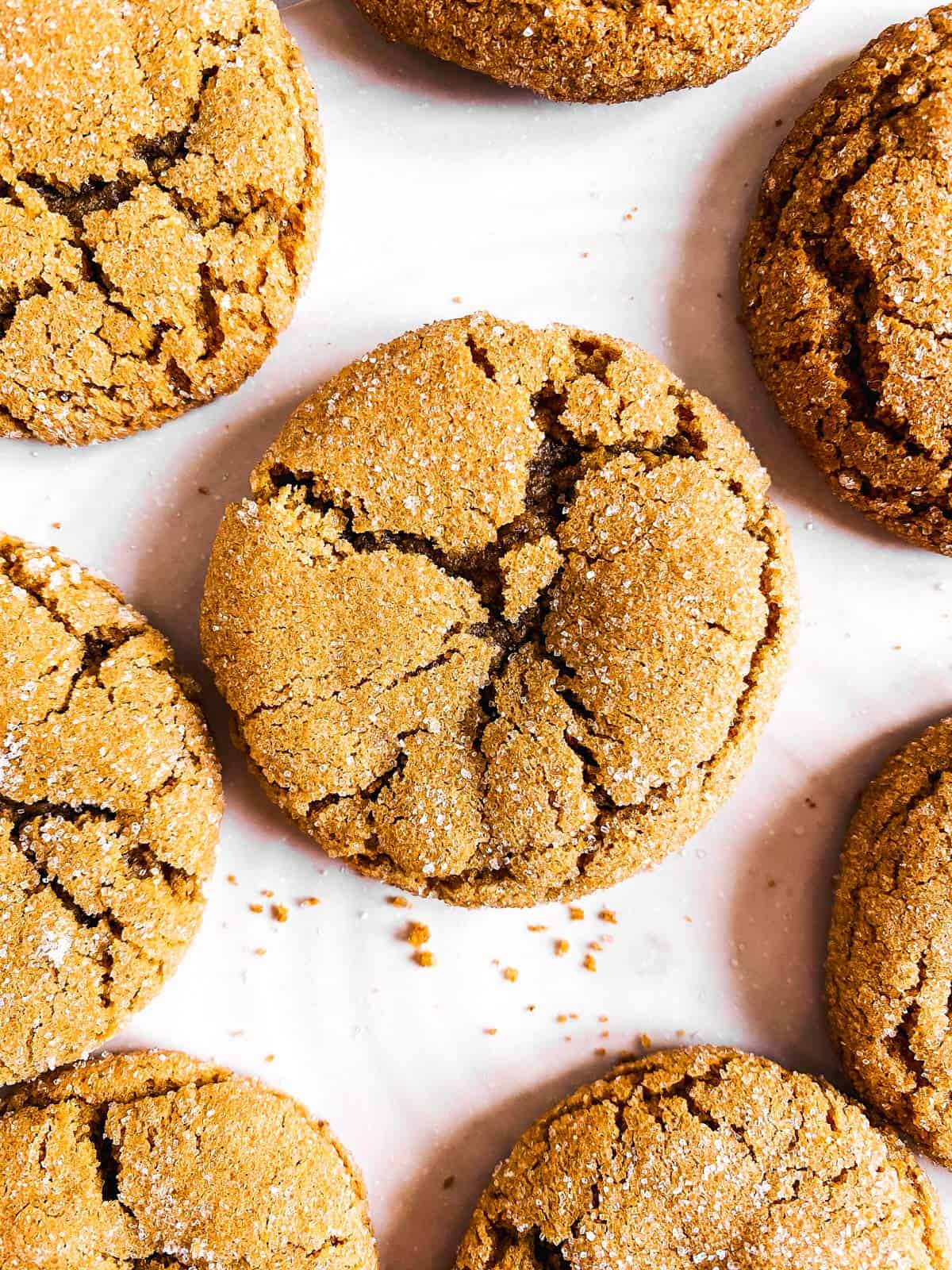 close up photo of ginger molasses cookie on white platter