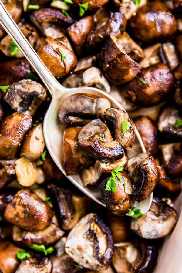 Garlic Butter Mushrooms with a spoon.