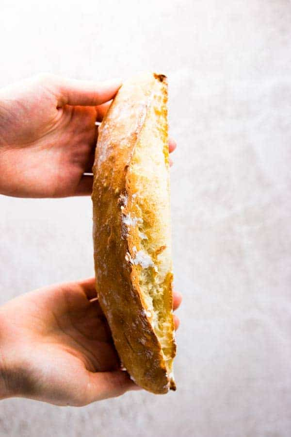 Holding a homemade French bread.