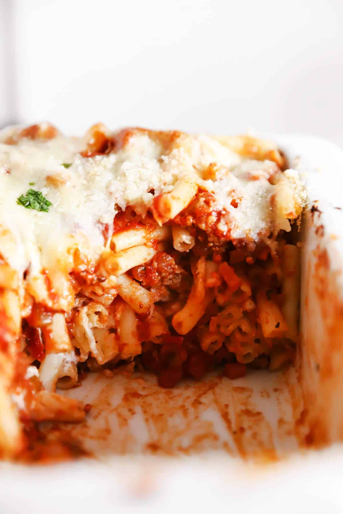 close up of baked ziti in casserole dish