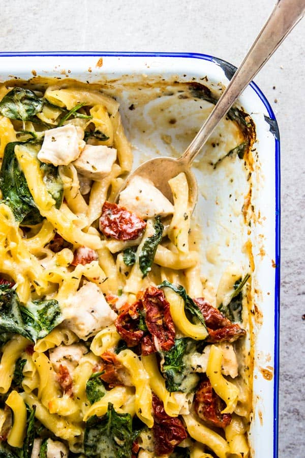 Chicken Florentine Pasta Casserole with part of it scooped out.