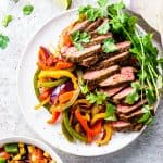 Steak fajitas on a serving platter.