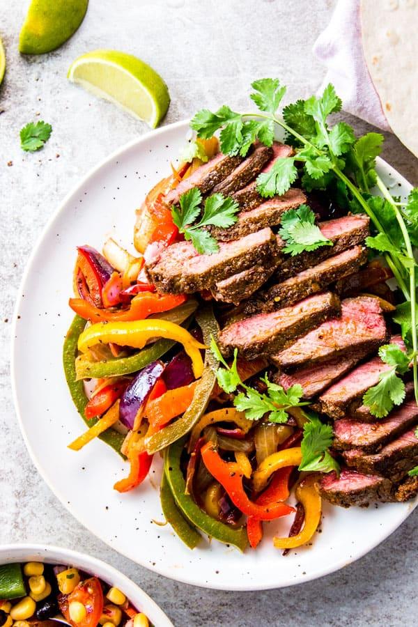 Steak fajitas on a plate.