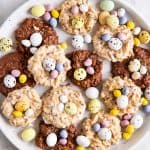 overhead view of white plate with bird's nest cookies and mini eggs