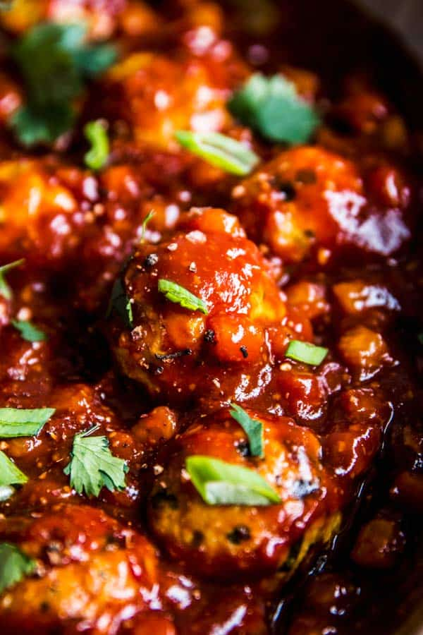 Close up photos of Pineapple BBQ Meatballs in a skillet.
