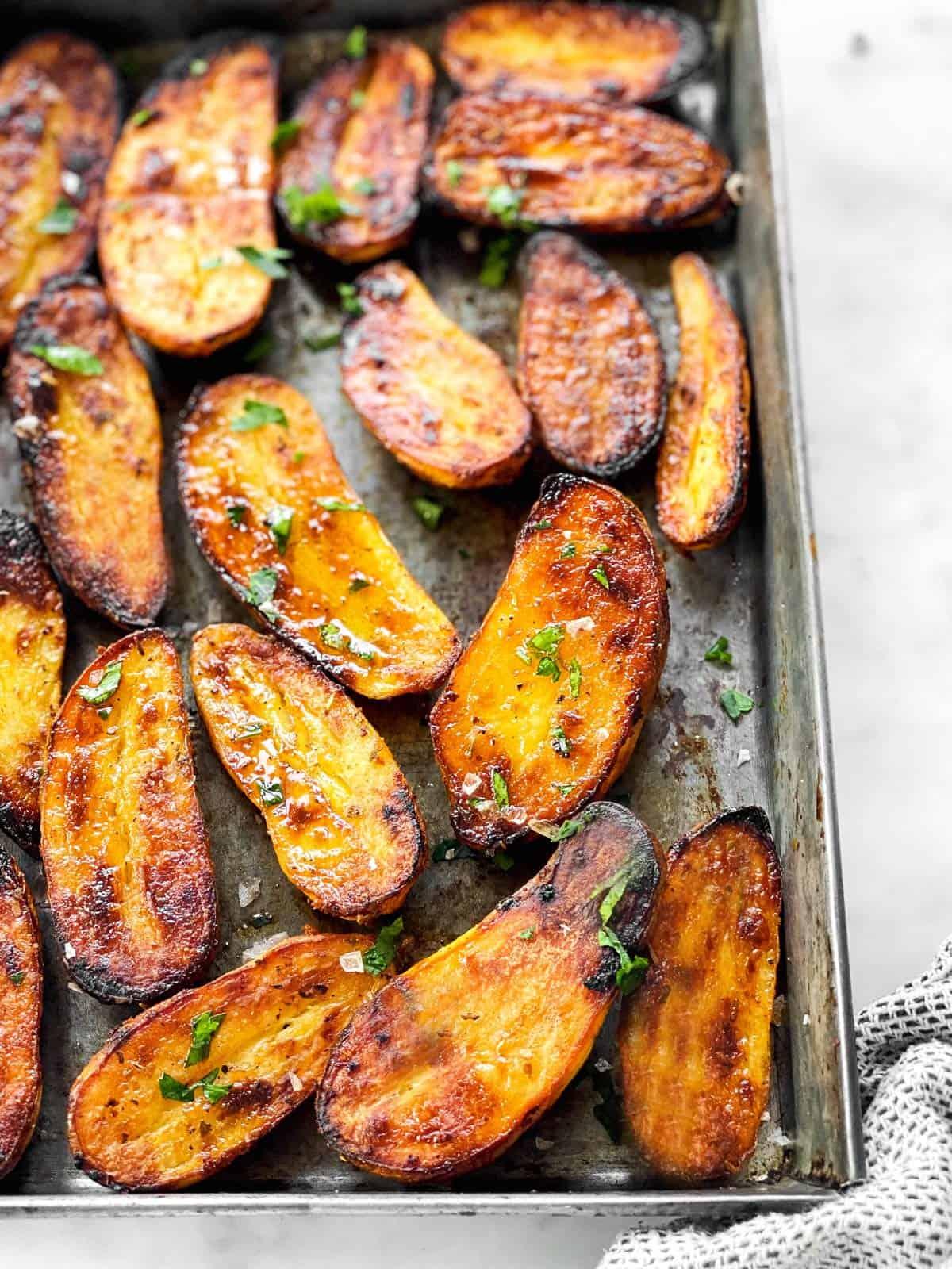 roasted fingerling potatoes on a metal pan