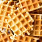 close up photo of buttermilk waffles on cooling rack