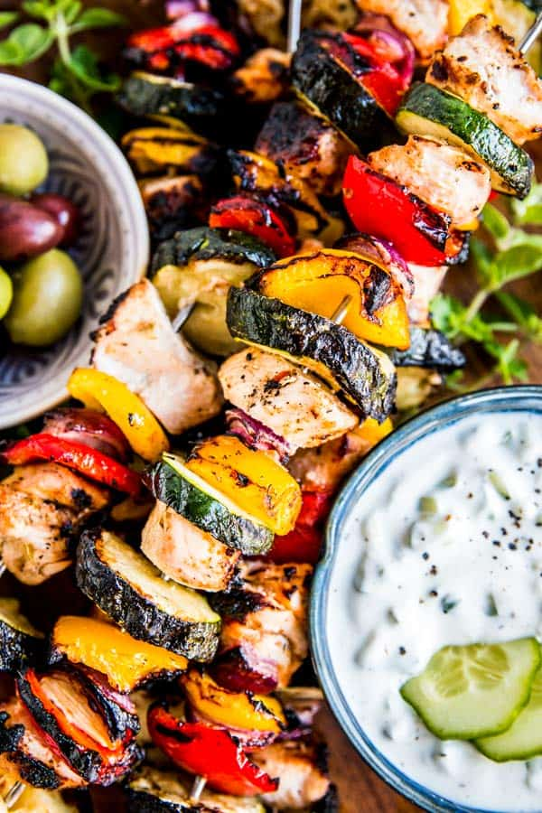 grilled greek chicken kabobs on a platter