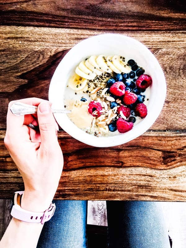 berry quinoa breakfast bowl on a wooden table