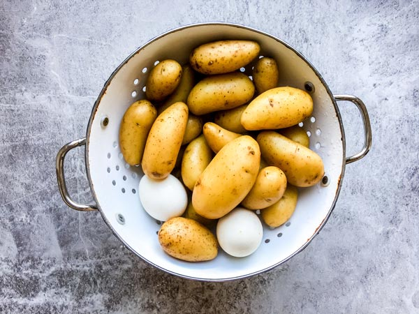 potatoes and eggs in a colander