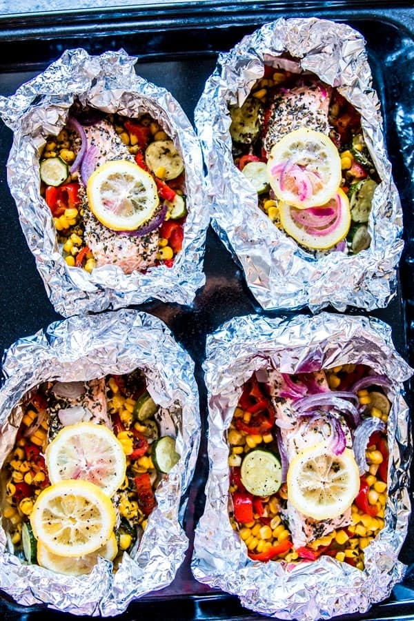four salmon foil packets opened