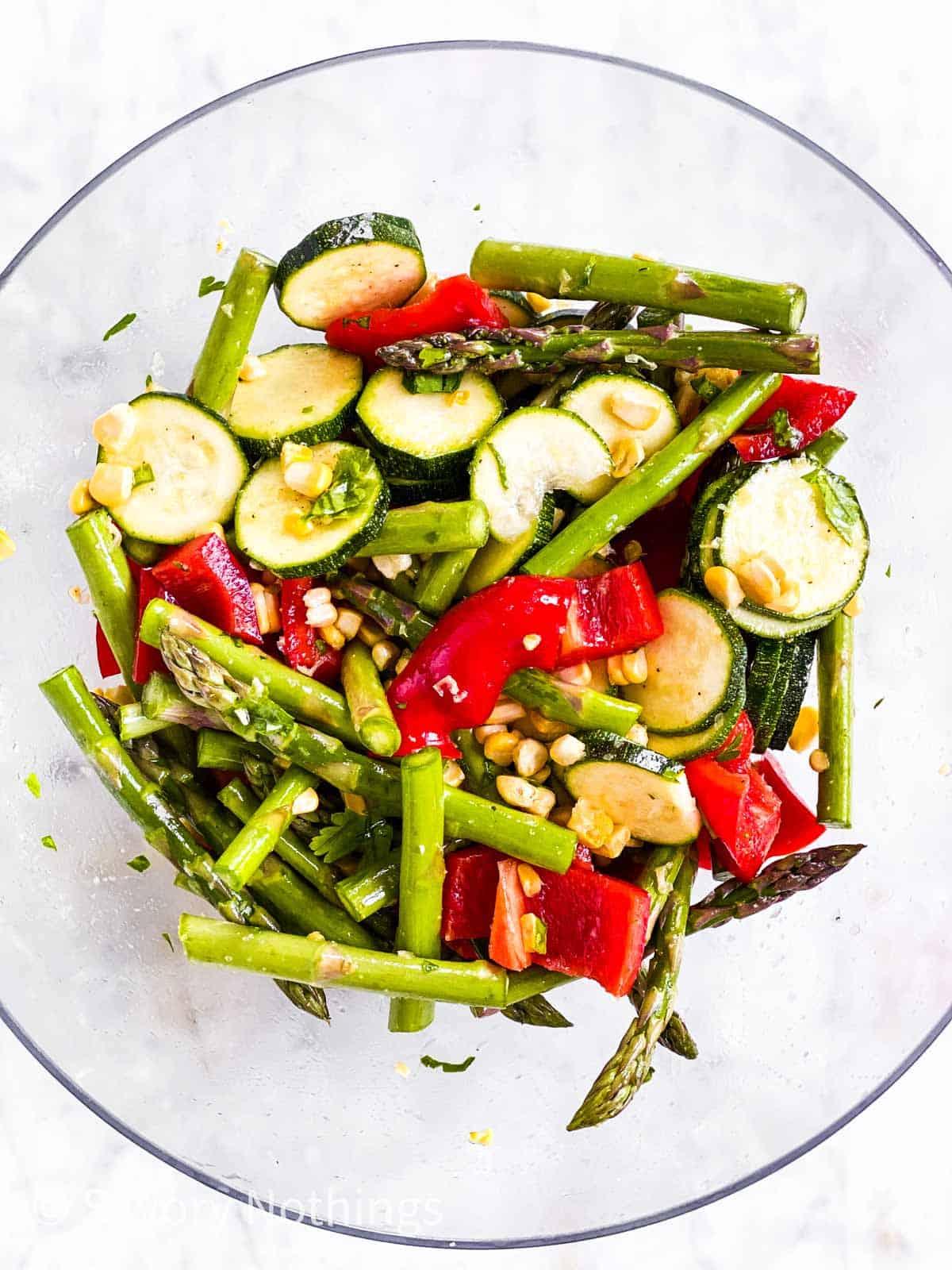 seasoned vegetables in glass bowl