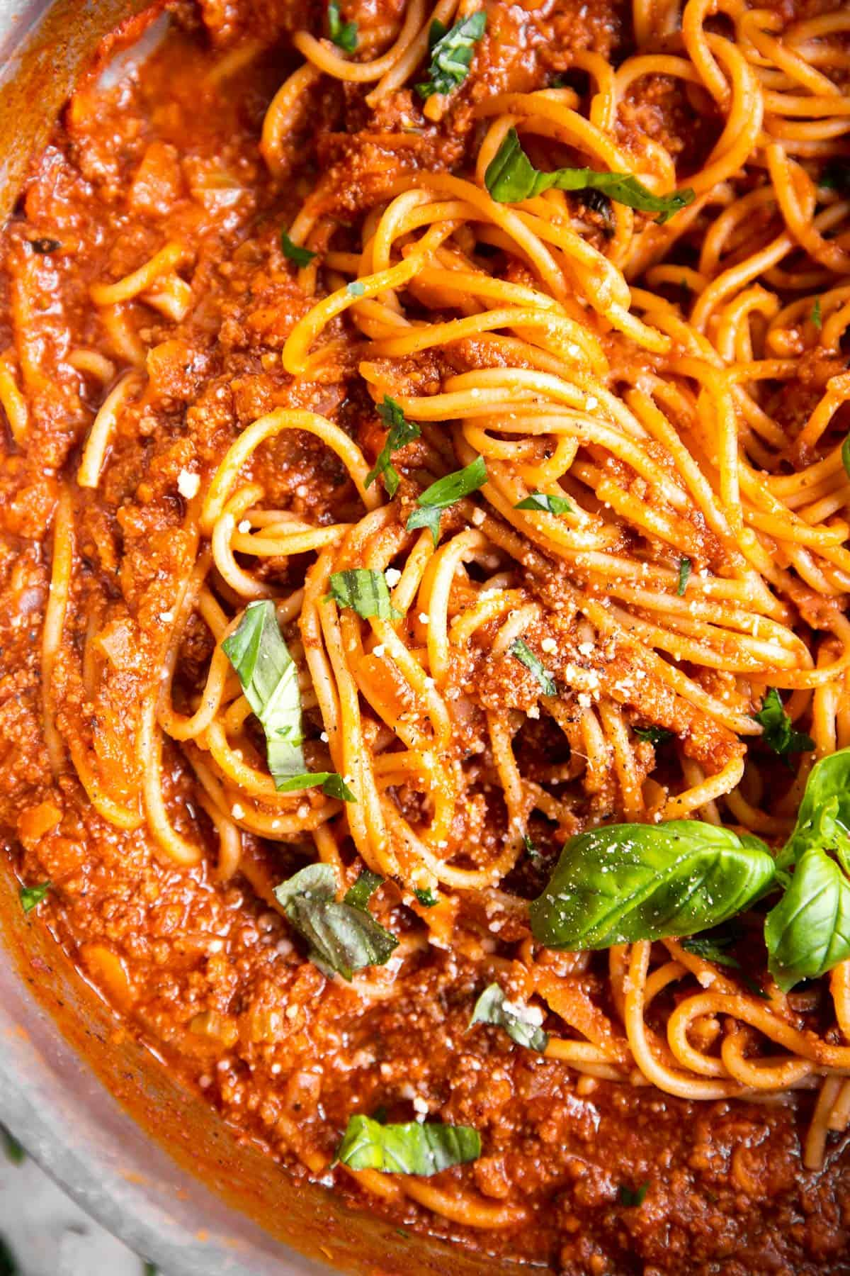 close up photo of spaghetti and meat sauce in pan
