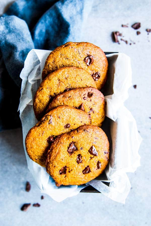 pumpkin chocolate chip cookies in a tin