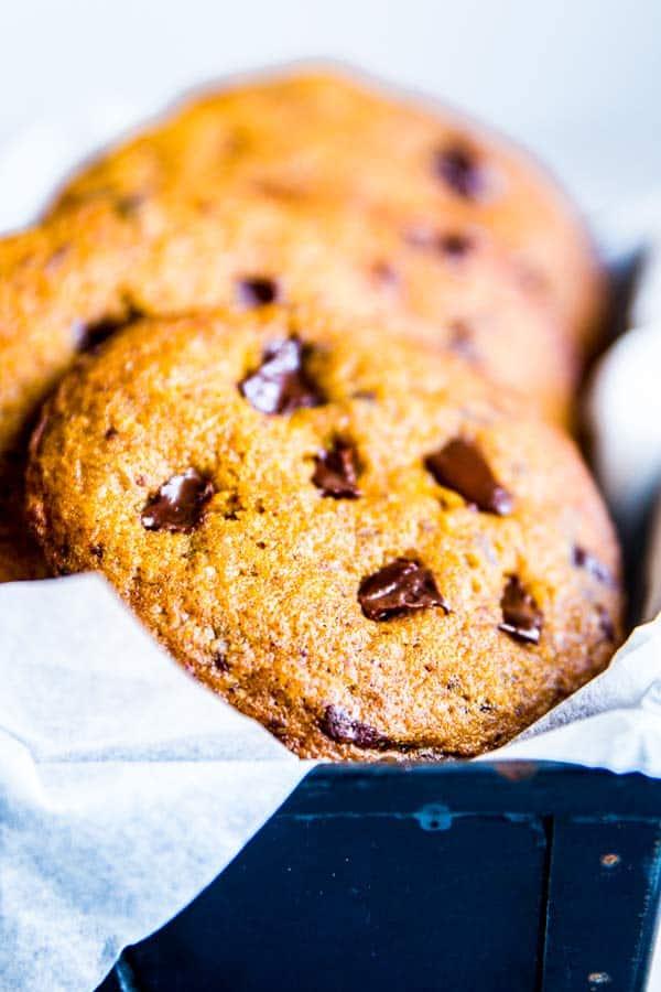 pumpkin chocolate chip cookies in a black tin