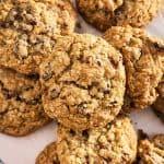 overhead closeup of pile of oatmeal raisin cookies