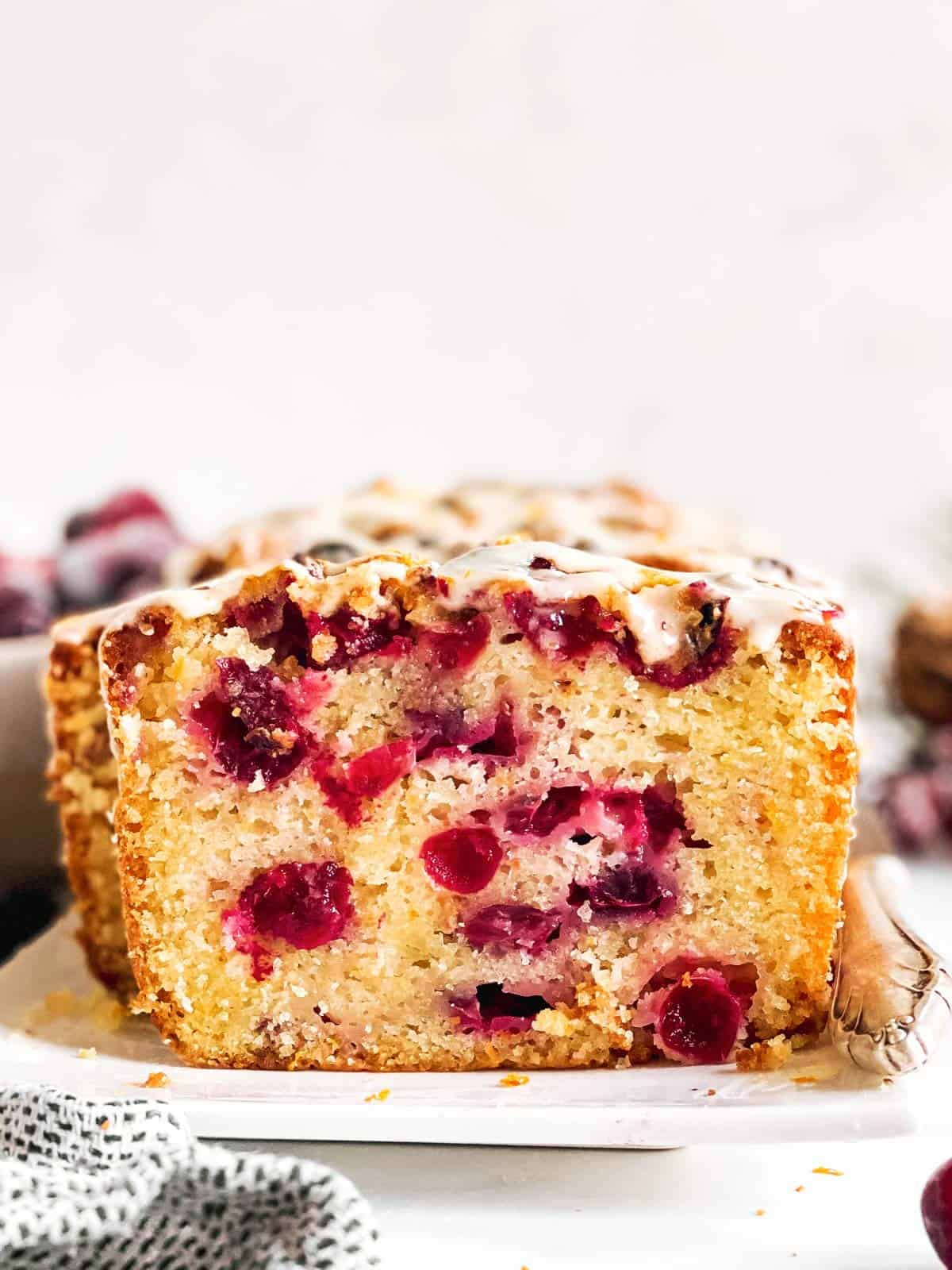 frontal view of sliced open cranberry orange bread