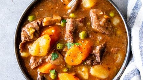 instant pot beef stew on a black plate