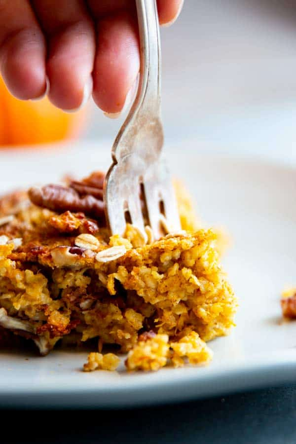 fork sticking in a slice of pumpkin baked oatmeal