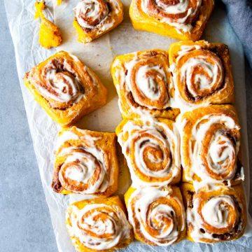 pumpkin cinnamon rolls on the counter