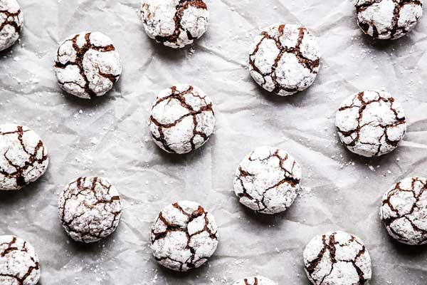 chocolate crinkle cookies on a parchment paper
