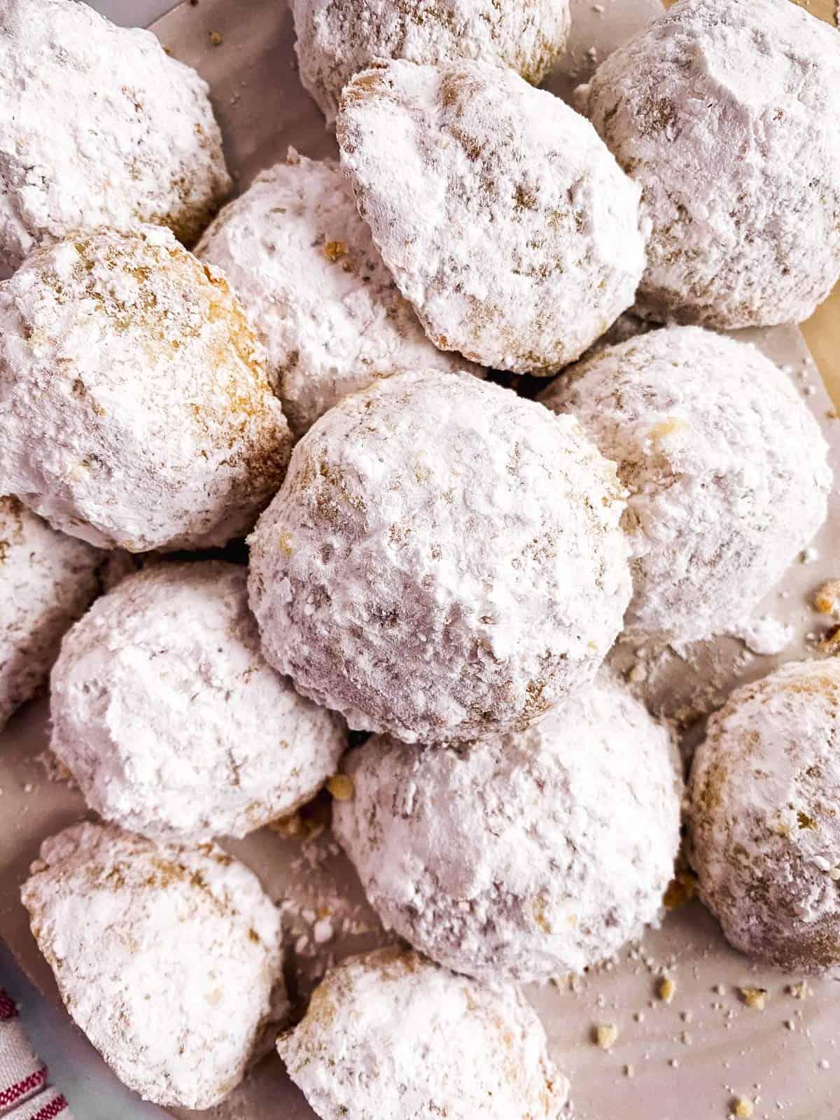 overhead closeup of a pile of pecan snowball cookies
