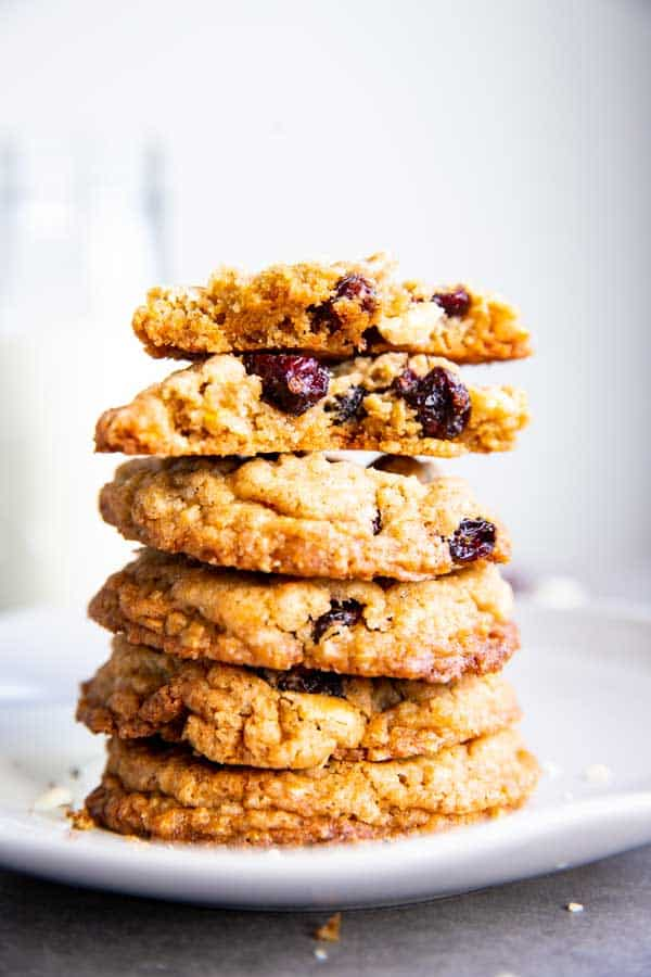 stack of White Chocolate Cranberry Oatmeal Cookies with a halved one on top