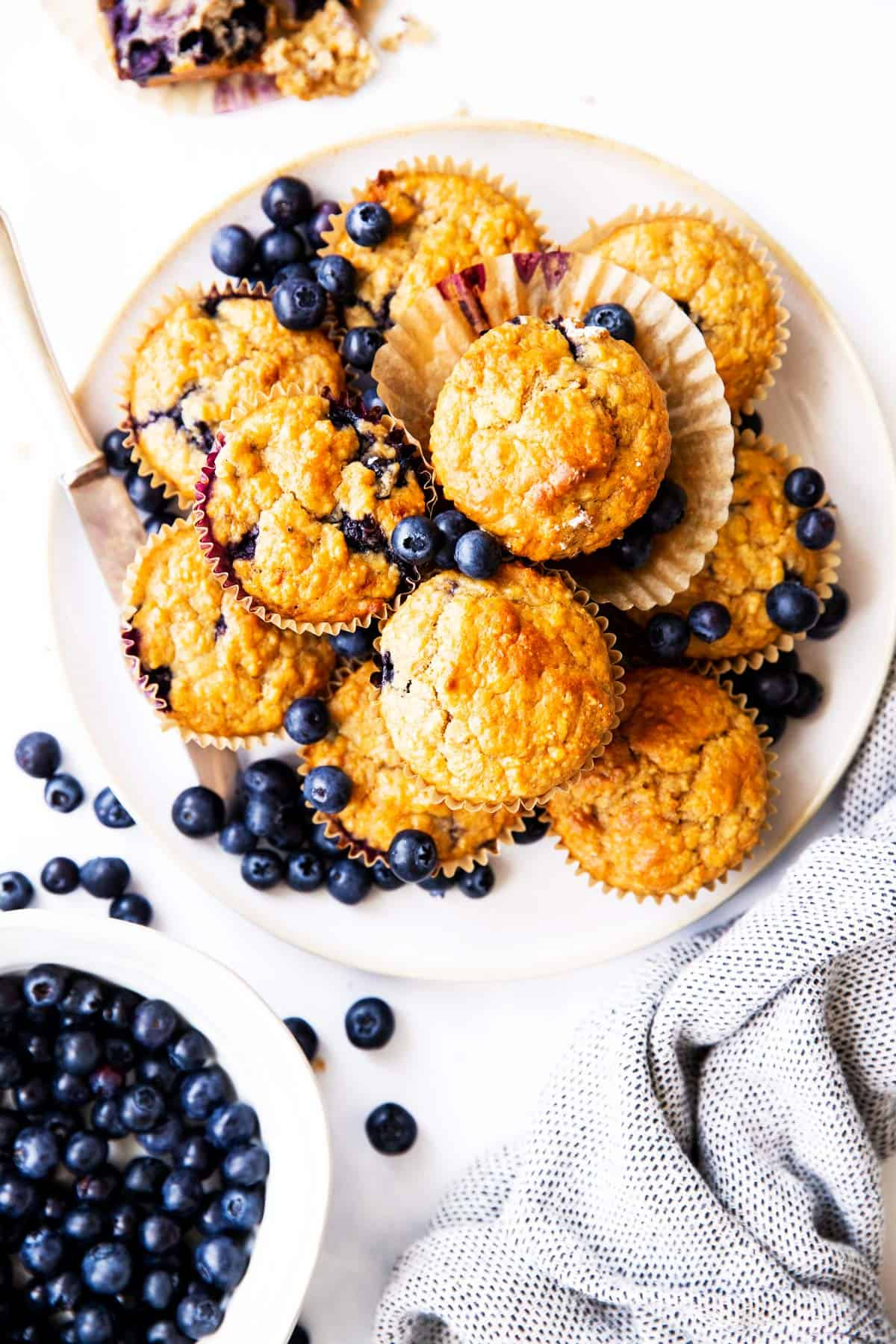 top down view on a plate filled with blueberry muffins
