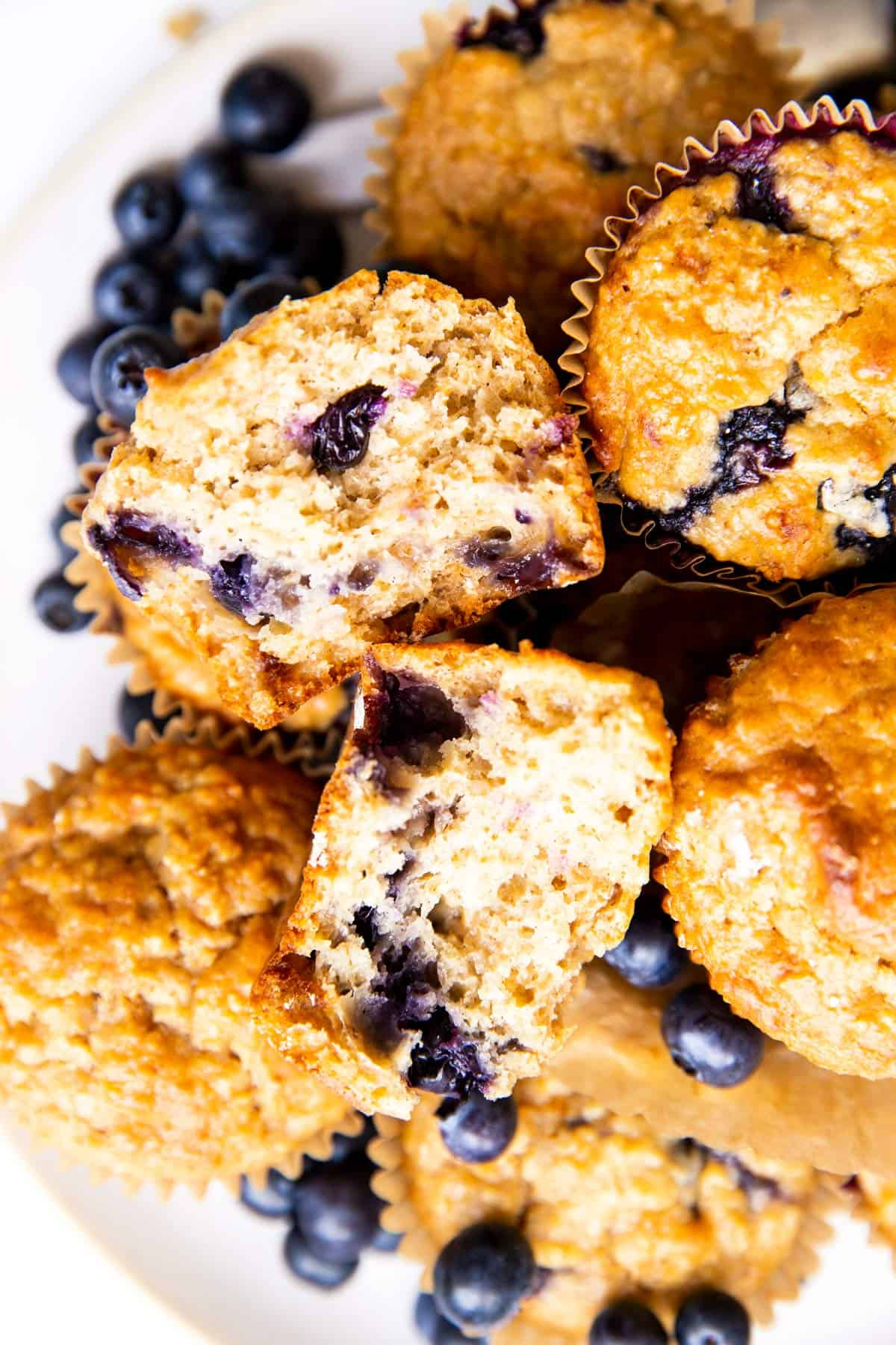 top down view on pile of muffins with one broken in half