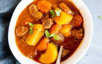 three white bowls with Irish stew