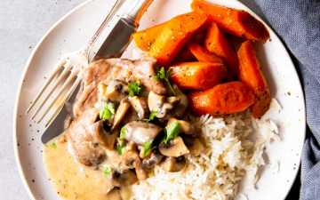 instant pot mushroom pork chops on a plate with rice and carrots
