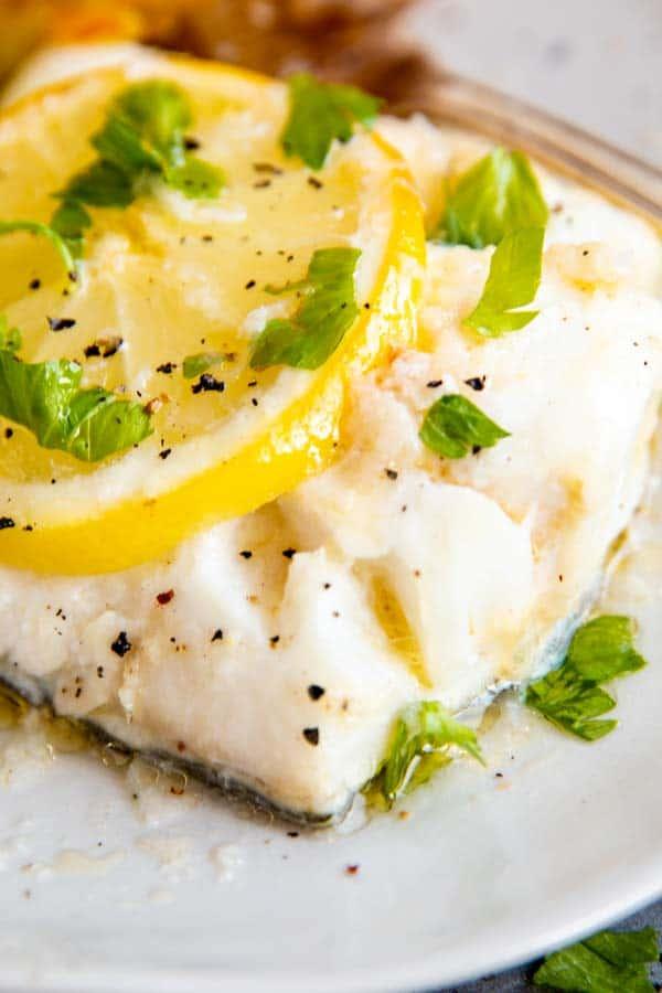 close up photo of garlic butter lemon baked cod