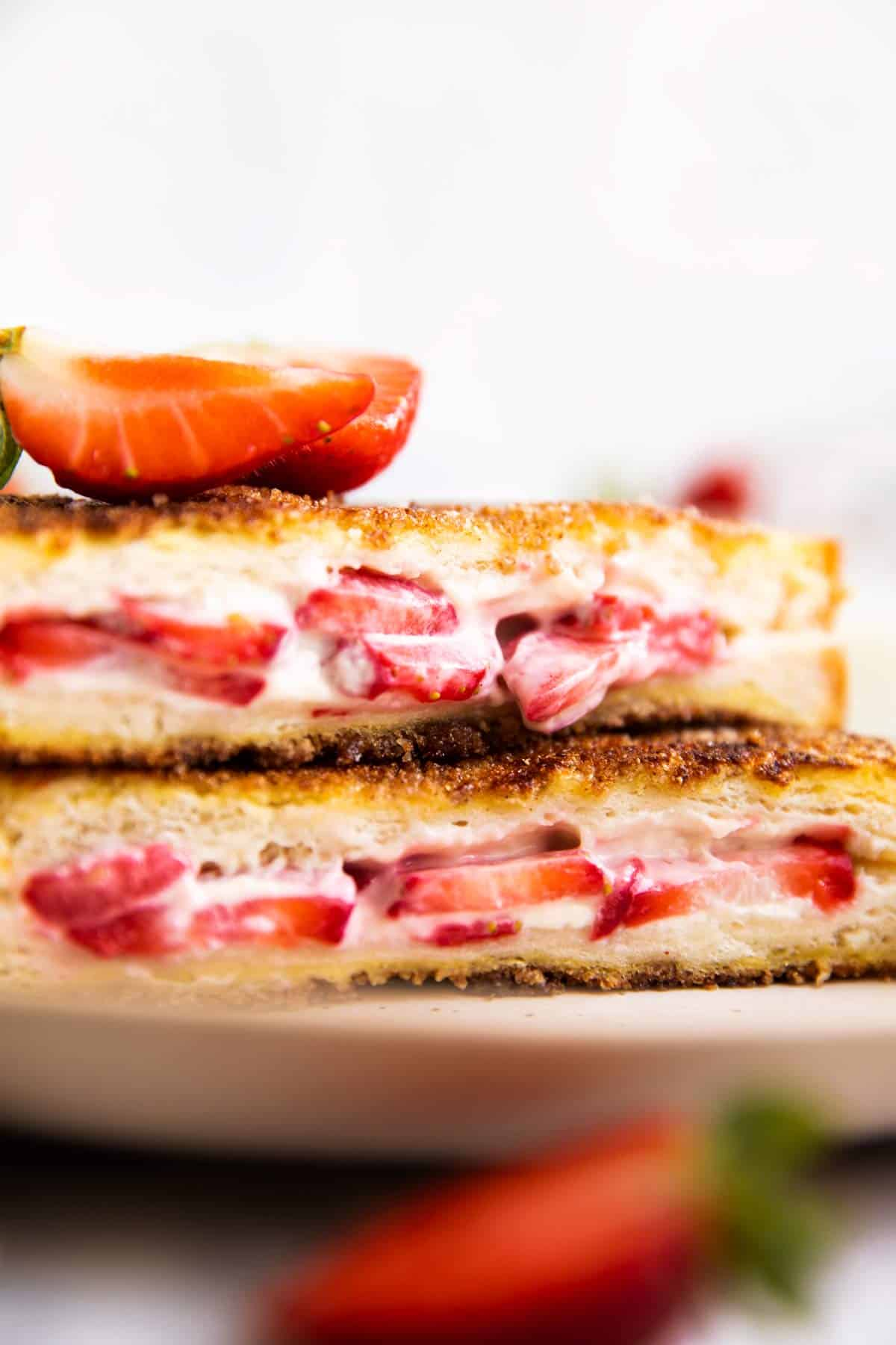 close up photo of strawberry filling in a stuffed French toast