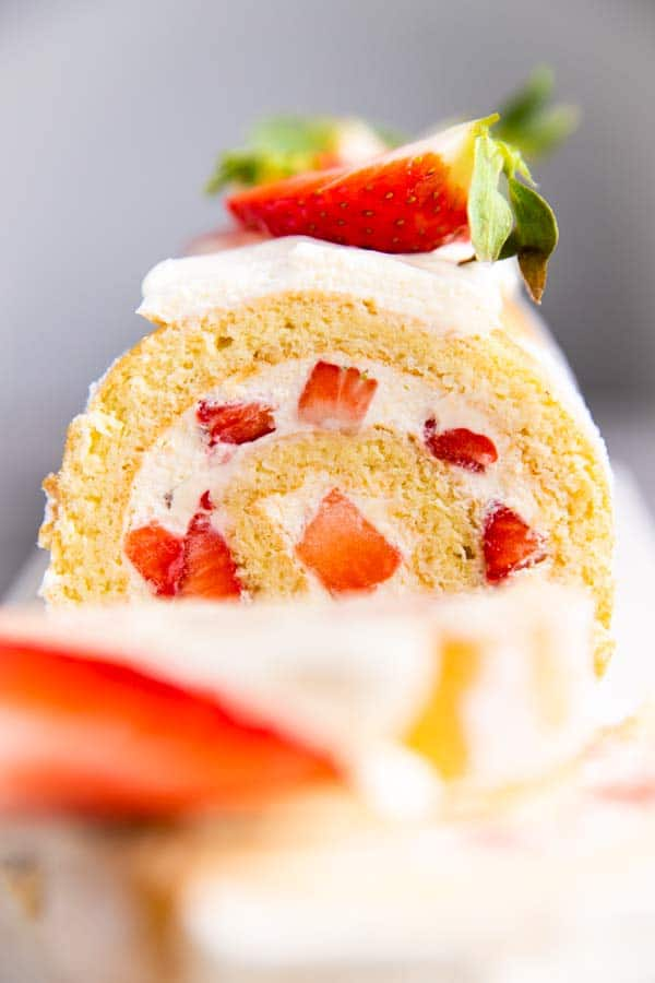close up photo of strawberry cake roll