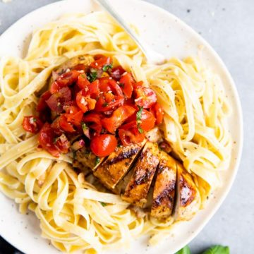 plate with pasta and balsamic bruschetta chicken