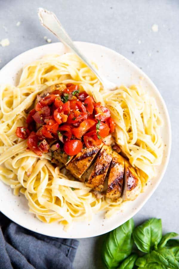 plate with pasta and balsamic bruschetta chicken