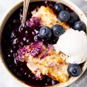 bowl with blueberry cobbler and ice cream