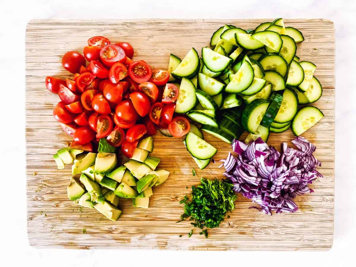 sliced vegetables on wooden chopping board