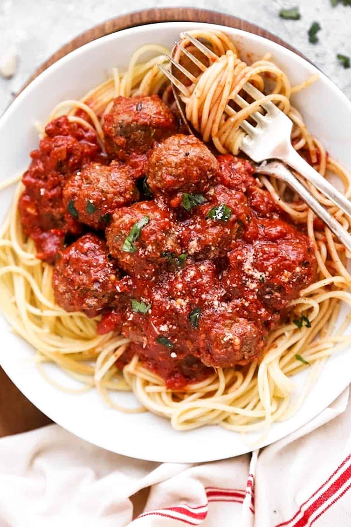 close up of plate with spaghetti and meatballs