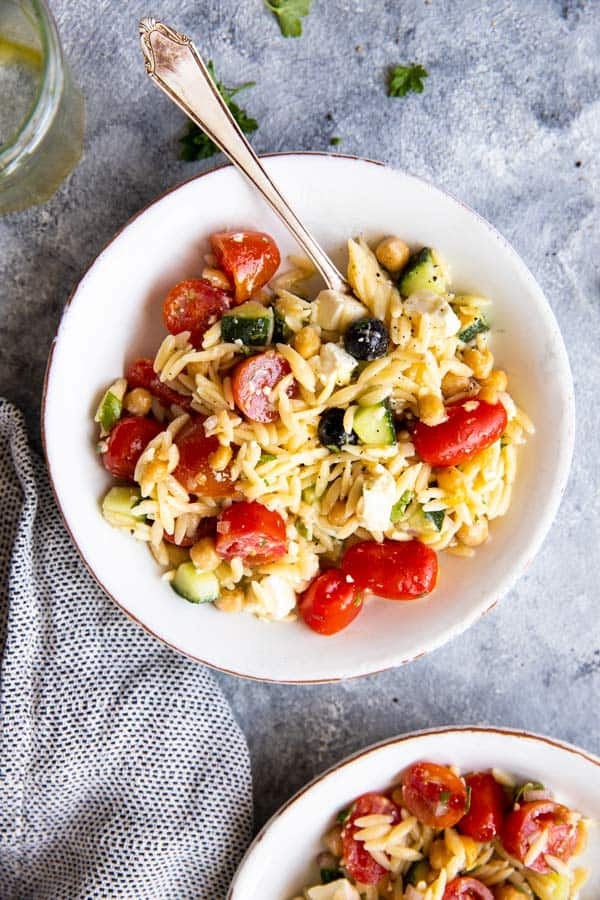plate with greek orzo salad
