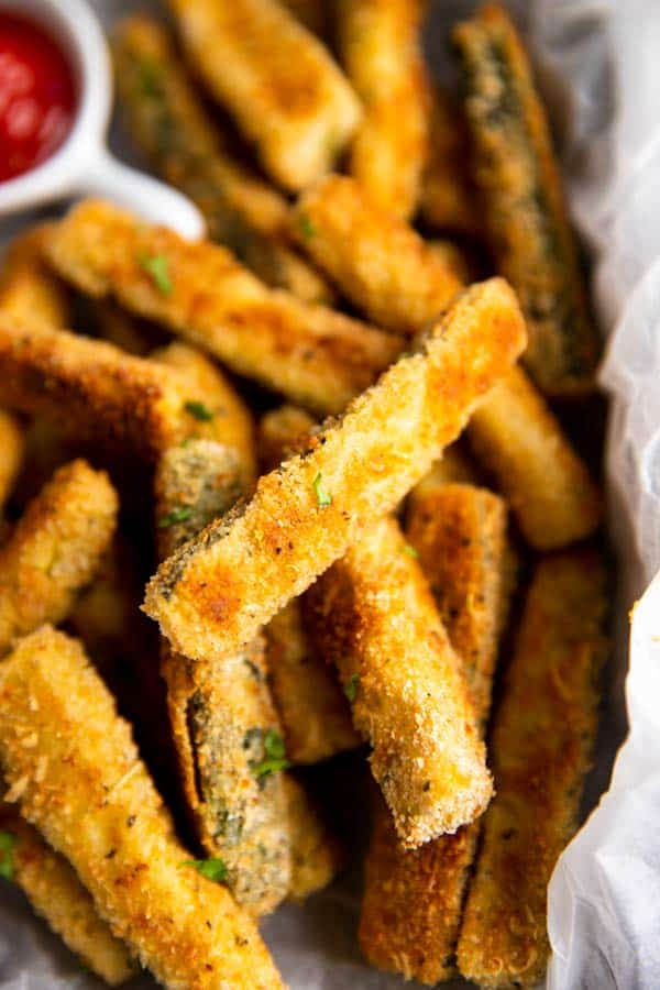close up of baked parmesan zucchini fries