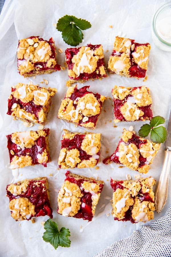 sliced strawberry oatmeal bars on parchment paper