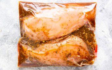 ziploc bag with chicken breast marinading in balsamic marinade
