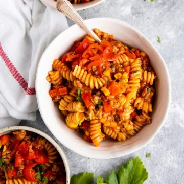 bowls with cheesy taco pasta on the table