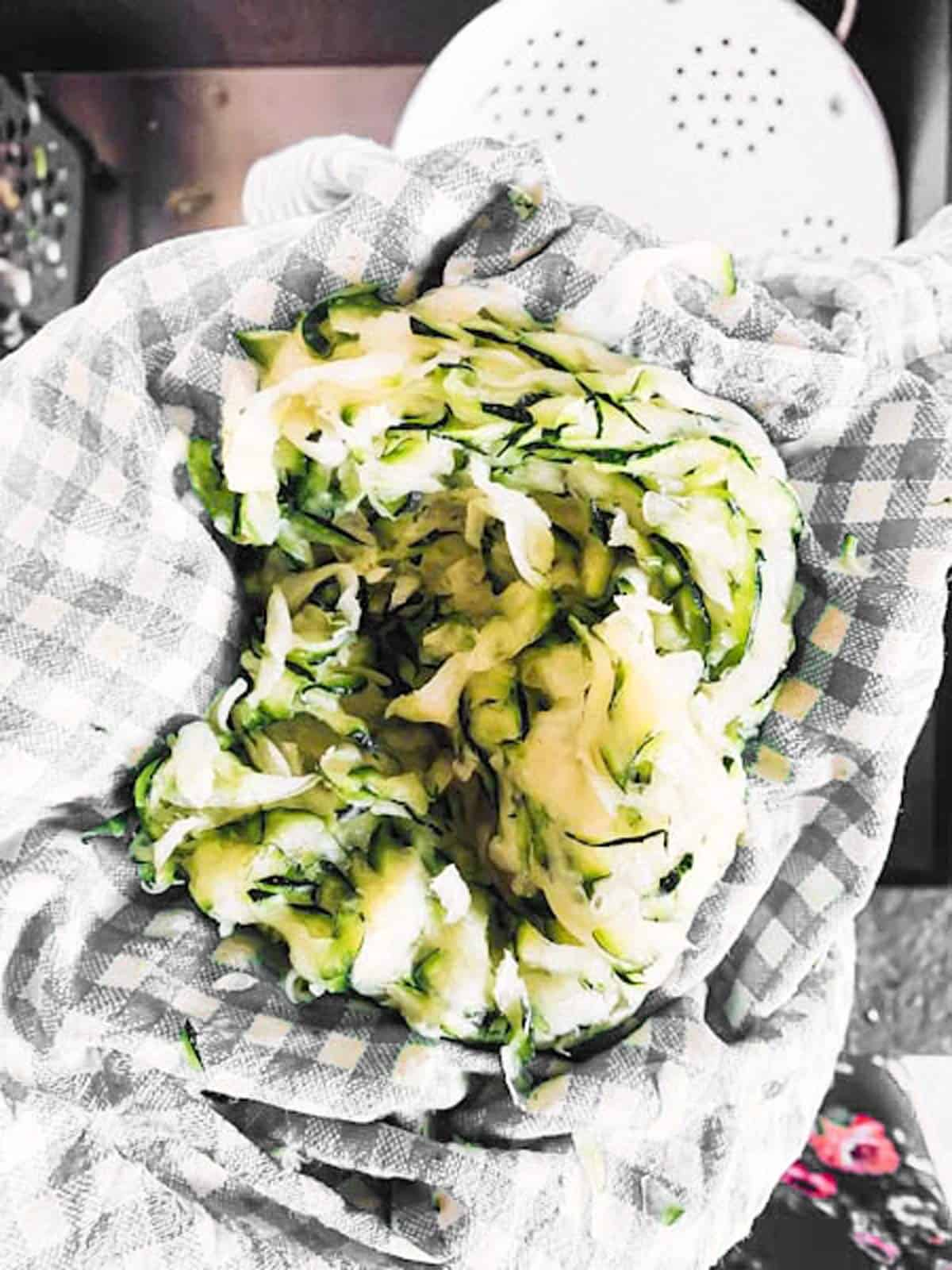 shredded zucchini in tea towel