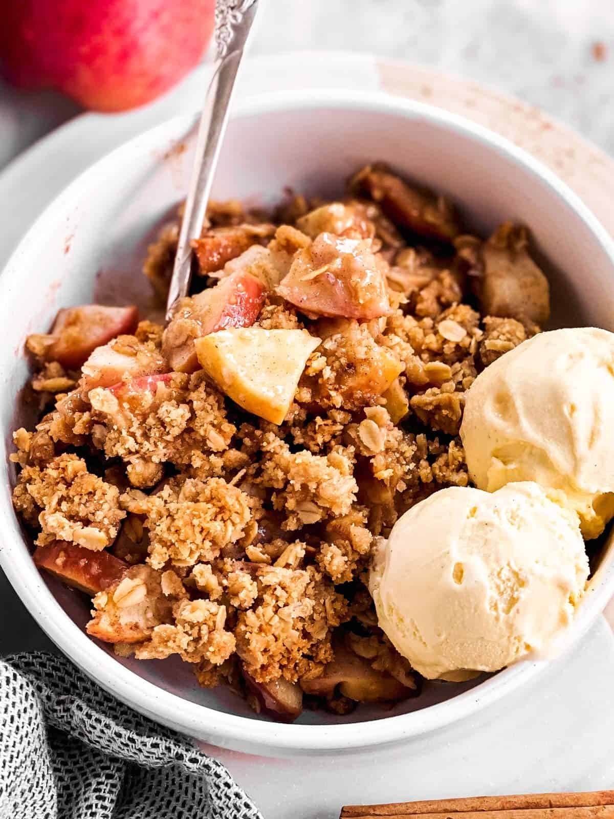 white bowl filled with apple crisp and ice cream