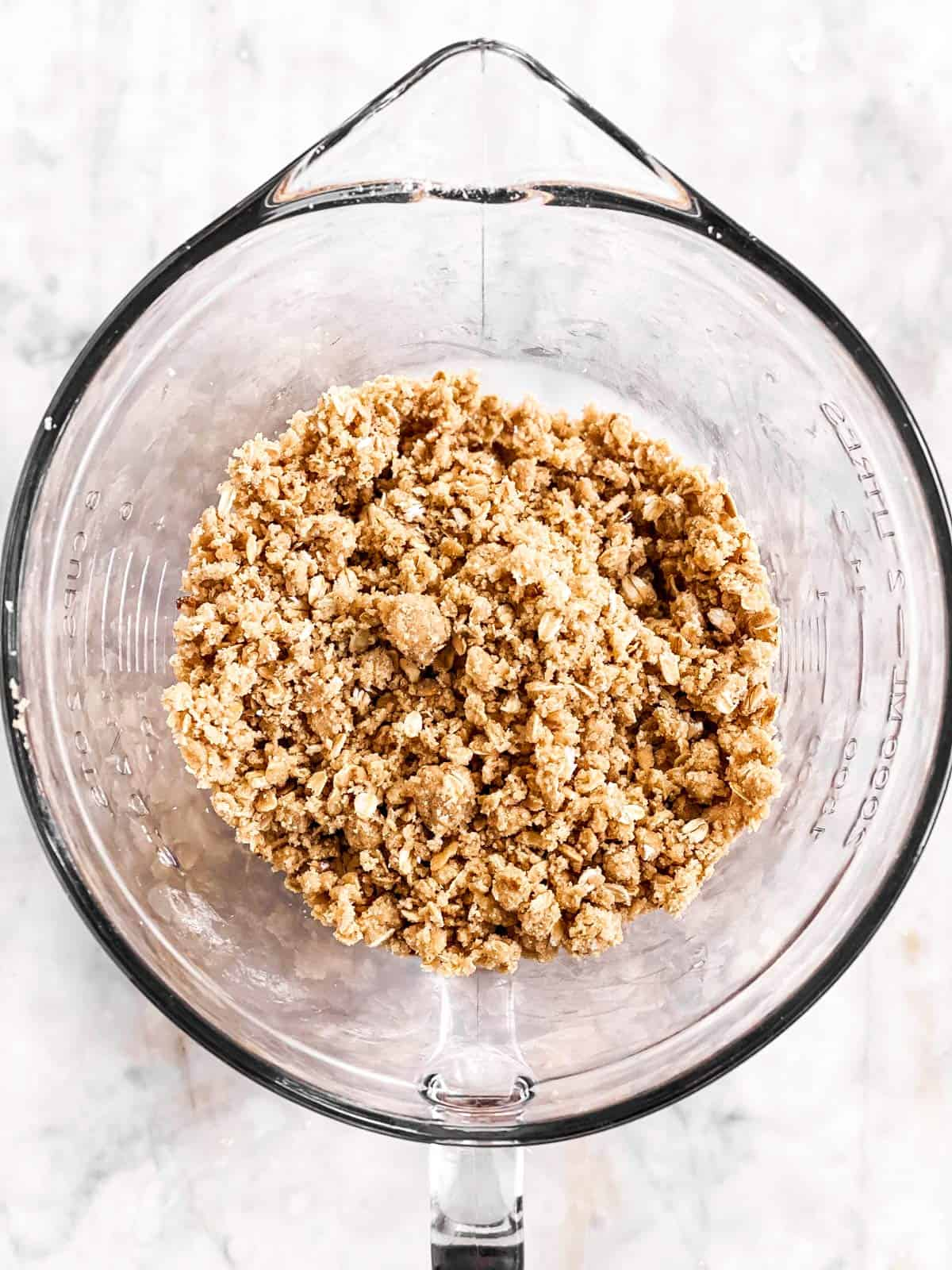 apple crisp topping in a glass bowl