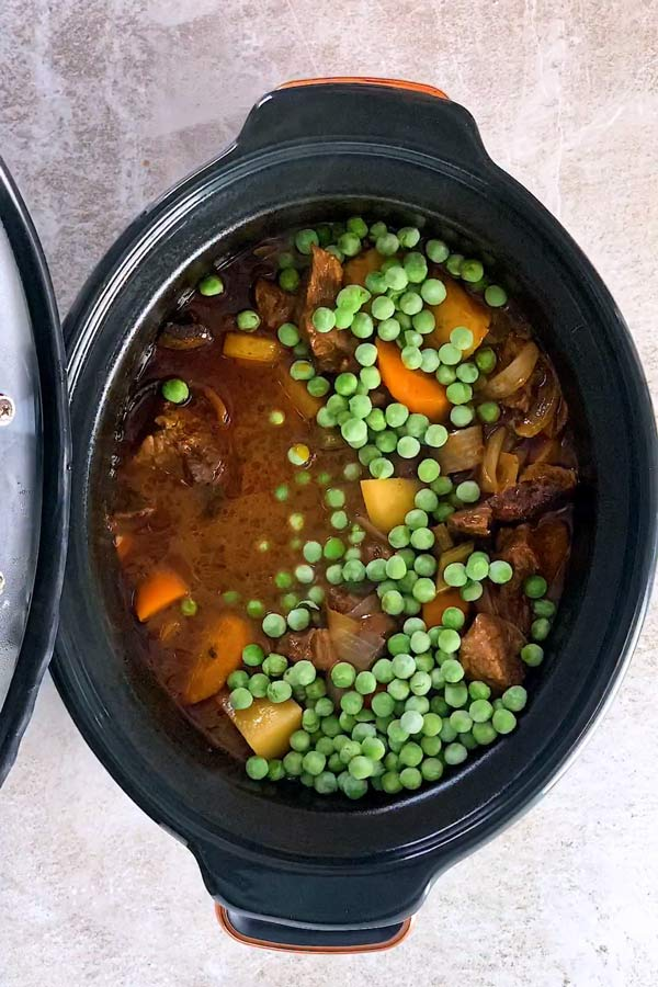 crock pot beef stew after cooking with frozen peas