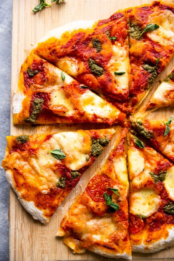 sliced pizza on a wooden board